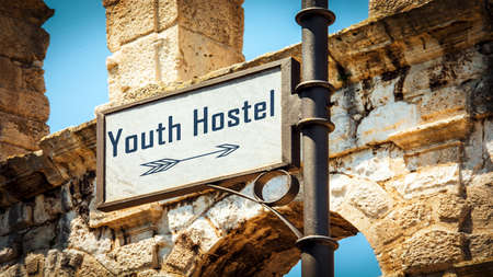 Street Sign the Direction Way to Youth Hostel Archivio Fotografico