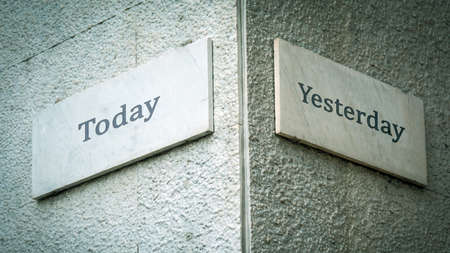 Wall Sign the Direction Way to Today versus Yesterday Archivio Fotografico