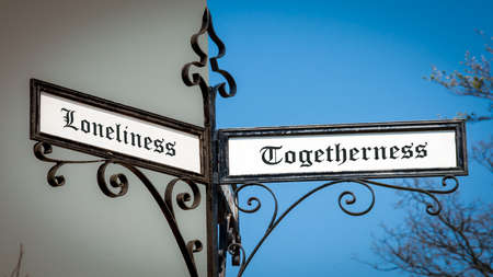 Street Sign the Direction Way to Togetherness versus Loneliness