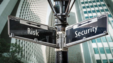 Street Sign the Direction Way to Security versus Risk Archivio Fotografico