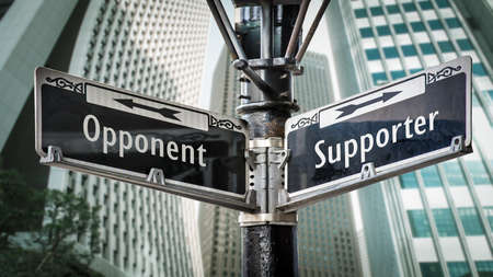 Street Sign the Direction Way to Supporter versus Opponent 免版税图像