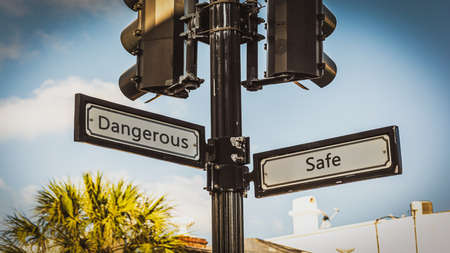 Street Sign the Direction Way to Safe versus Dangerous