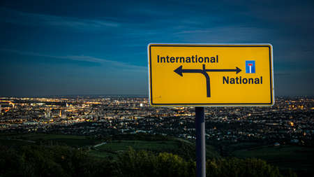 Street Sign the DIrection Way to International versus National