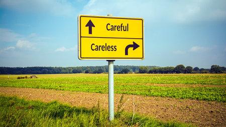 Street Sign the Direction Way to Careful versus Careless Stockfoto