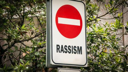 Street Sign the Direction Way to Tolerance versus Rassism Stock fotó