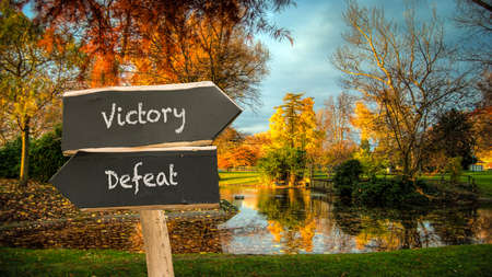 Street Sign the Direction Way to Victory versus Defeat Archivio Fotografico