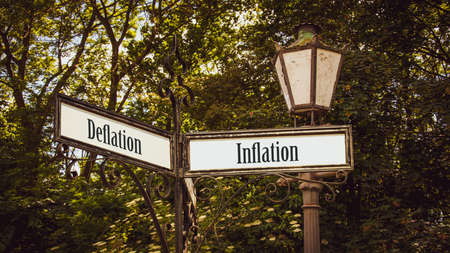 Street Sign the Direction Way to Inflation versus Deflation Archivio Fotografico