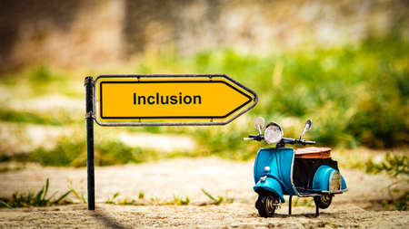 Street Sign the Direction Way to Inclusion Stock Photo