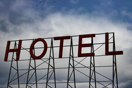 Red Hotel Sign Standing Tall