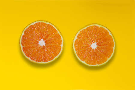 slices of orange on yellow background