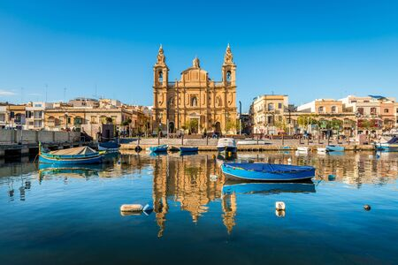 Church and fishing boats in Sliema on the island of Malta