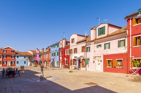 Canal and its typical facades on the island of Burano in Venice in Veneto, Italy