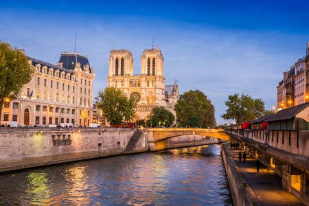 The Seine river and Notre-Dame cathedral in Paris, France Stock Photo