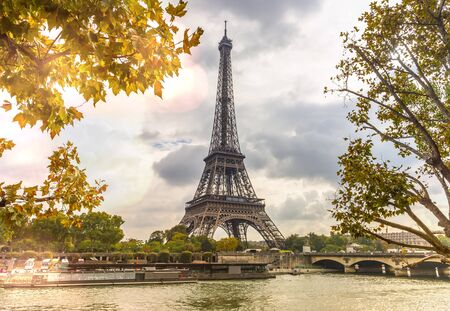 The famous Eiffel Tower in autumn on the Seine in the capital Paris in France Stockfoto