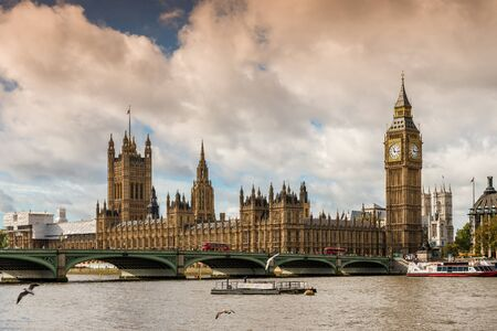 Houses of Parliament and Westminster Bridge over the River Thames in London in England in UK