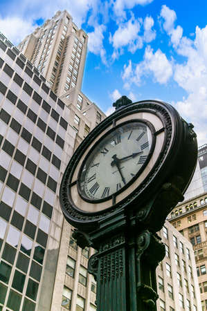 Clock on a street in Manhattan, New York, USA