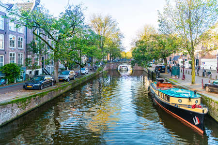 Panoramic of a typical canal in Amsterdam in Holland in the Netherlands