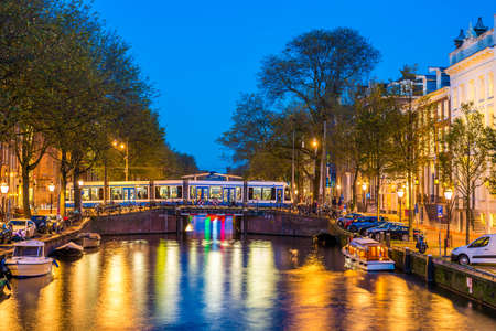 A tram at night in Amsterdam, Netherlands