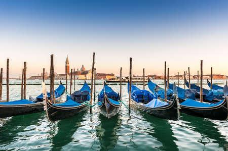 Gondolas and San Giorgio Maggiore Island in the background in the Venice Lagoon in Veneto, Italy