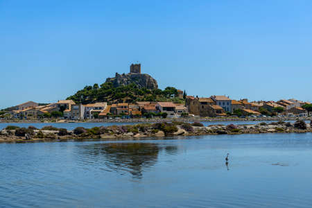 The ponds and the old Gruissan and the Barberousse tower in the background, in Aude in Occitanie, France