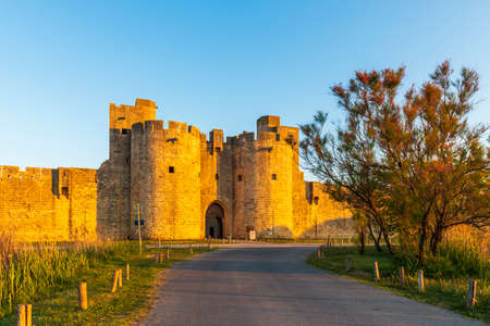 Gate and east ramparts, Aigues-Mortes in the early morning, in the Gard in Occitanie, France