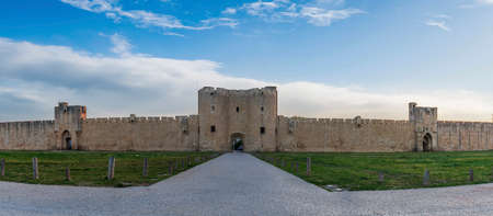Gates and south ramparts, Aigues-Mortes in the early morning, in the Gard in Occitanie, France Editorial