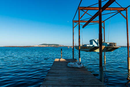 Oyster farm on the Thau lagoon and Mont Saint Clair in the background, in Bouzigues, Occitanie, France