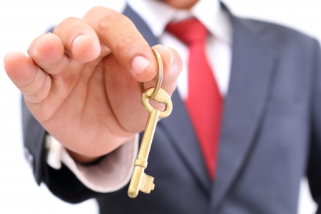 businessman showing the golden key to success photo