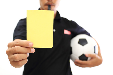 arbiter: Referee showing a yellow card on white background