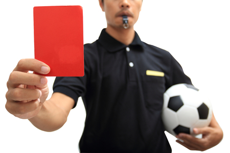 arbiter: Referee showing a red card on white background Stock Photo