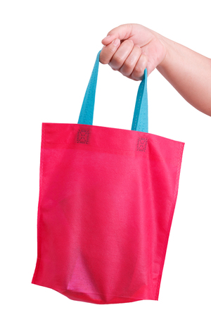 reusable: closeup hand holding reusable bag isolate on white clipping path