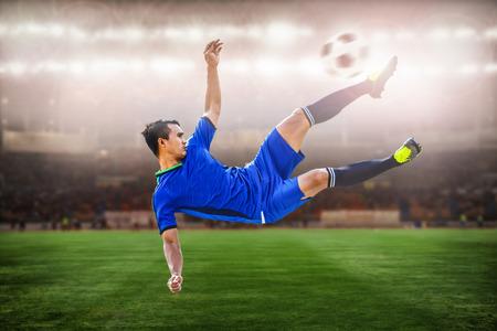 striker: closeup of soccer striker shooting ball in the stadium Stock Photo
