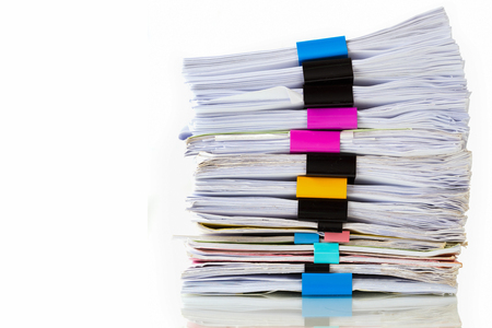 disarray: Pile of documents with colorful clips on white background