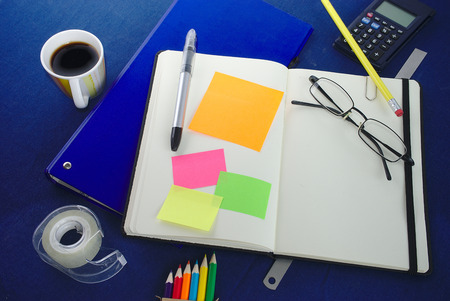 white notebook and colorful labels. spaces to receive text. Office supplies