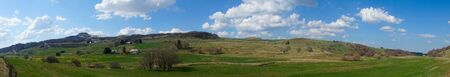 Besse and Saint Anastaise, panoramic view of the Puy de Dome countryside in the spring