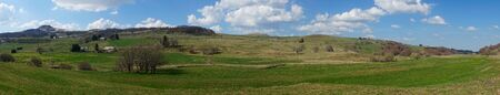Besse and Saint Anastaise, panoramic view of the Puy de Dome countryside in the spring Фото со стока - 124702700