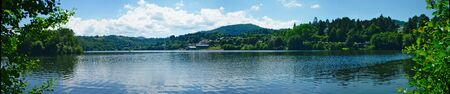 panoramic view of Lake Aydat, Auvergne, Puy-de-Dome Фото со стока - 124703981