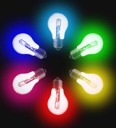 six standard light bulbs; in the color of the rainbow. In a circle on a black background