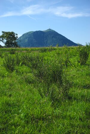 view of Puy-de-Dome in the spring 版權商用圖片 - 124989297