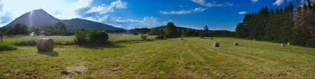 Panoramic shooting on the Puy-de-Dome. Foreground and bales of hay. Auvergne. la France