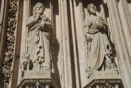 sculptures of Saint-Marc and Saint-Jean, details of the door of the Saint-Maclou church, in Rouen
