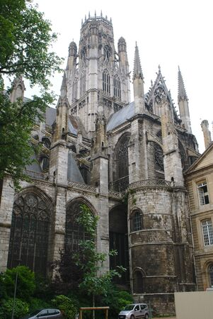 Saint-Ouen Abbey in Rouen in Normandy, France. Gothic style. View of the gardens of the Hotel de Ville, low-angle shot.