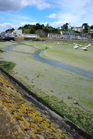 Port of Binic at low tide in Brittany in the Cotes dArmor Imagens