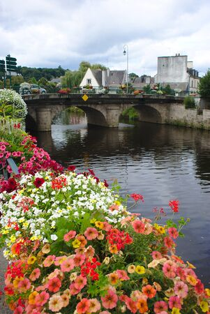 canal from Nantes to Brest in the city center of pontivy in Brittany, in Morbihan. Flowers in the foreground