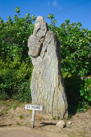 statue of the monk of the island of the monks in Brittany, Morbihan. This natural rock evokes the silhouette of a monk and is one of the elements of Cromlech Kergenan