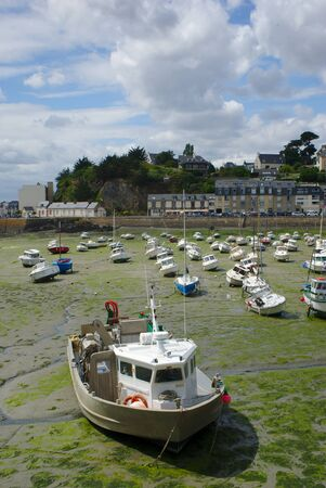 boats stranded on the port of Binic, at base tide, in Brittany in the coasts of Armor Stock Photo