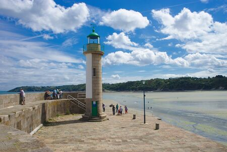 Lighthouse port Binic at low tide in the coast of Armor in Brittany 写真素材