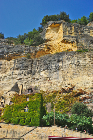 view of the cliffs and the architecture of the Roque Gageac village of the dordogne