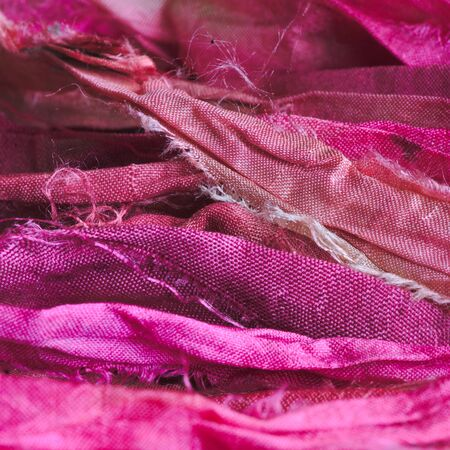 Pink silk ribbons background. Texture. Close-up shot, macro photography.