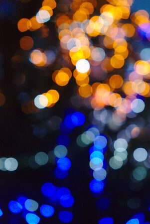 abstract background, blurred bokeh effect, multicolored christmas lights